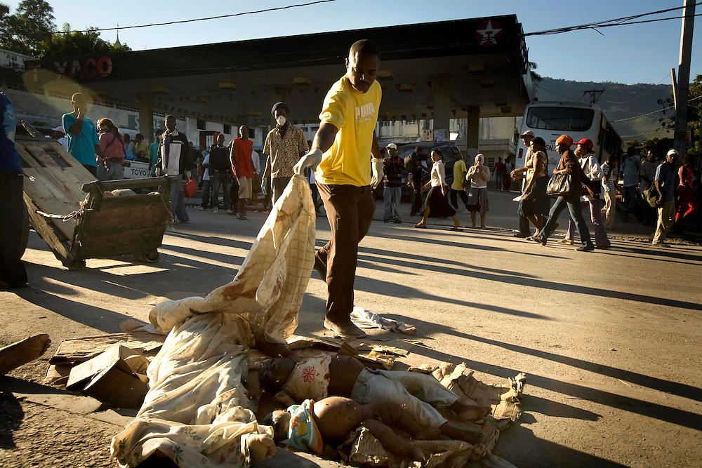 Bodies are piled up and put on streets as people are trying to cope with the massive destruction at Port-au-Prince and much of the country of Haiti after a massive earthquake that has killed thousands on Thursday January 14, 2010.