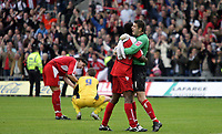 Photo: Rich Eaton.<br /> <br /> Oxford United v Leyton Orient. Coca Cola League 2. 06/05/2006.<br /> <br /> Goal keeper Glyn Garner celebrates whilst in backgroung John Mackie commiserates with Steve Basham (no 9)
