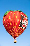 DEU, Germany, Sauerland region, Warstein, international balloon festival in Warstein, balloon of the company Schwartau in the shape of a strawberry [the balloon festival in Warstein is the biggest in Europe, more than 250 balloons from all over the world participate, sponsor is the Warsteiner brewery].<br /> <br /> DEU, Deutschland, Sauerland, Warstein, Internationale Montgolfiade in Warstein, Ballon der Firma Schwartau in Form einer Erdbeere [die Montgolfiade in Warstein ist die groesste in Europa, es nehmen ueber 250 Ballone aus aller Welt teil, Sponsor ist die Warsteiner Brauerei].