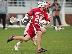 Maryland Terrapins Midfield Jeff Reynolds (28) in action against UVA.  The #9 ranked Maryland Terrapins fell to the #1 ranked Virginia Cavaliers 10 in 7 overtimes in Men's NCAA Lacrosse at Klockner Stadium on the Grounds of the University of Virginia in Charlottesville, VA on March 28, 2009.