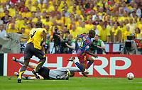 Photo: Richard Lane.<br />Arsenal v Barcelona. UEFA Champions League Final. 17/05/2006.<br />Arsenal's Jens Lehmann brings down Barcelona's Eto'o and is sent off.