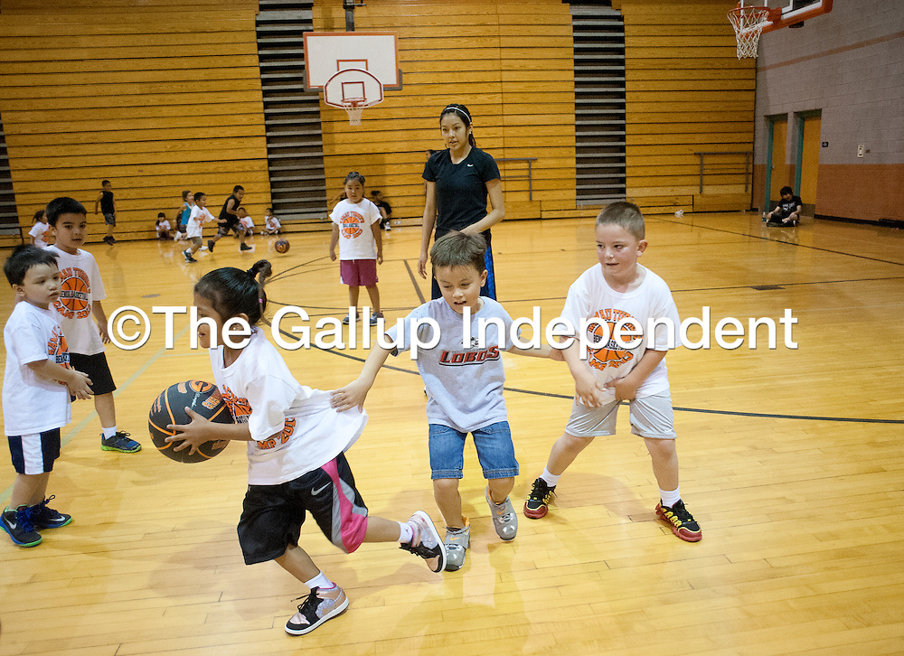 060613       Adron Gardner\Independent<br /> <br /> Gallup Bengal Kaylee Tsinginie watches over young basketball campers during the girls and boys basketball camp at Gallup High School in Gallup Thursday.