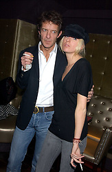 The HON.SOPHIA HESKETH and ROBIE UNIACKE at the launch party of Purple Lounge - a new poker web site, held at The Cuckoo Club, Swallow Street, London W1 on 30th November 2005.<br />