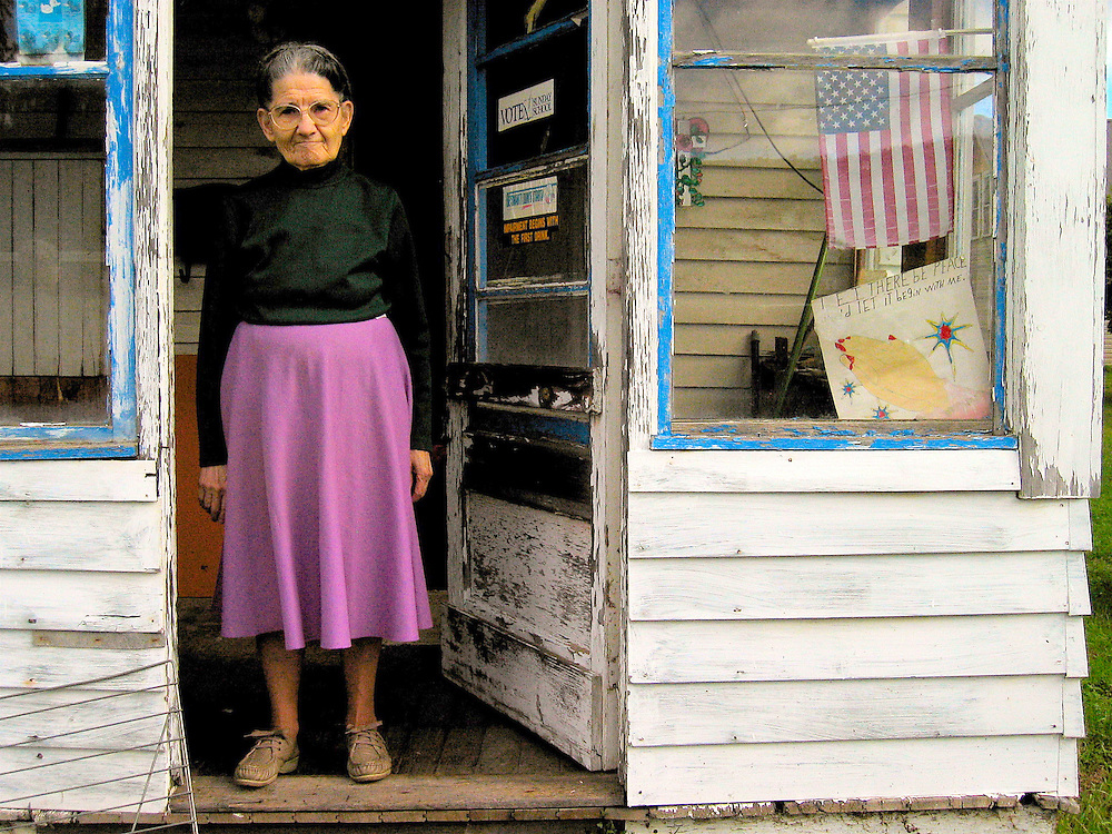 Preachers wife in in her doorway in Coudersport, PA