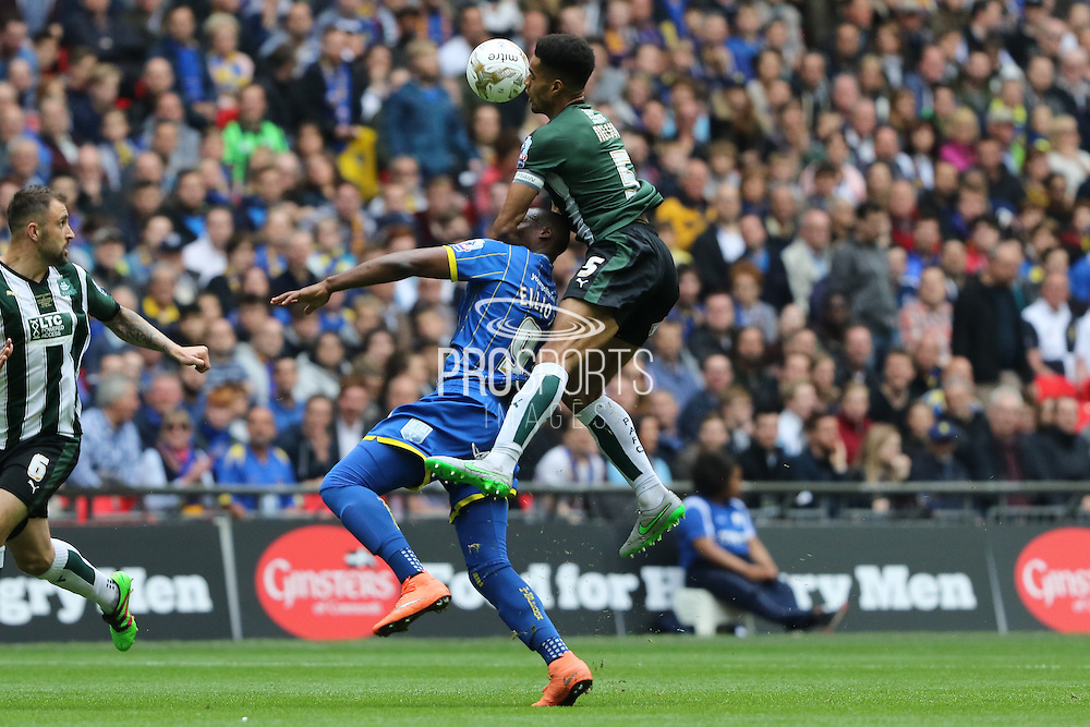 Plymouth Argyle defender Curtis Nelson (5) and Tom Elliott forward for AFC Wimbledon (9) in an ariel battle during the Sky Bet League 2 play off final match between AFC Wimbledon and Plymouth Argyle at Wembley Stadium, London, England on 30 May 2016. Photo by Stuart Butcher.