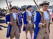 """11 NOVEMBER 2013 - PHOENIX, AZ: High school students dresses as Continental Army soldiers of the Revolutionary War walk through the Phoenix Veterans Day Parade grounds. The Phoenix Veterans Day Parade is one of the largest in the United States. Thousands of people line the 3.5 mile parade route and more than 85 units participate in the parade. The theme of this year's parade is """"saluting America's veterans.""""      PHOTO BY JACK KURTZ"""