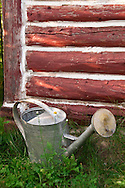 Detail of watering can and daisy at the Republic Island Cottage  on the Michigamme River near Republic Michigan.