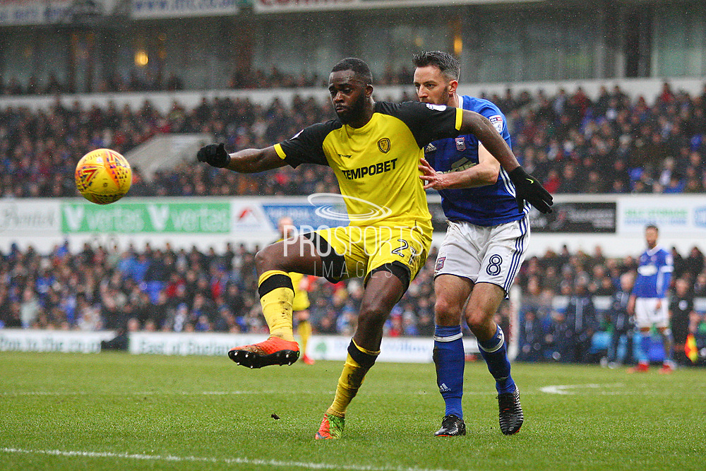 Burton Albion's Hope Akpan and Ipswich Town's Cole Skuse during the EFL Sky Bet Championship match between Ipswich Town and Burton Albion at Portman Road, Ipswich, England on 10 February 2018. Picture by John Potts.