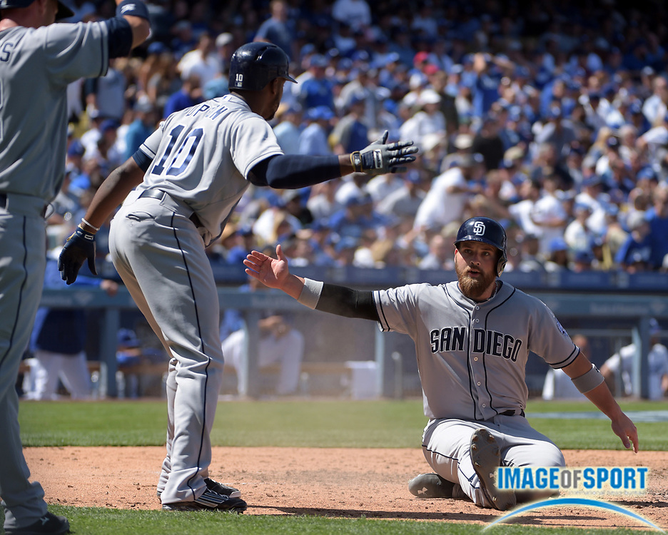 Apr 6, 2015; Los Angeles, CA, USA; San Diego Padres catcher Derek Norris (3) is congratulated by left fielder Justin Upton (10) after scoring in the fifth inning against the Los Angeles Dodgers in the 2015 MLB opening day game at Dodger Stadium. The Dodgers defeated the Padres 6-3.