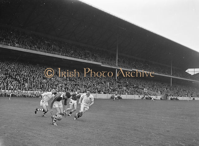 Cork player bounces ball off foot during the All Ireland Minor Gaelic Football Final Cork v. Galway in Croke Park on the 26th September 1960.