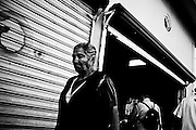 America, Latinoamerica, Mexico, Ensenada.  A old woman walks out a second hand warehouse -15.08.2006, DIGITAL PHOTO, 48MB, copyright: Alex Espinosa/Gruppe28.