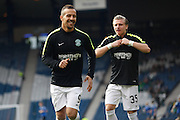 Hibernian FC Forward Farid El Alagui and Hibernian FC Forward Jason Cummings warming up during the Scottish League Cup Final match between Hibernian and Ross County at Hampden Park, Glasgow, United Kingdom on 13 March 2016. Photo by Craig McAllister.