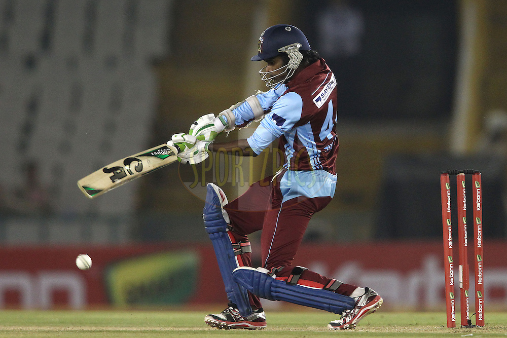 Upul Tharanga of Kandurata Maroons square drives a delivery during the Qualifier 2 match of the Karbonn Smart Champions League T20 (CLT20) between Sunrisers Hyderabad and the Kandurata Maroons held at the Punjab Cricket Association Stadium, Mohali on the 17th September 2013<br /> <br /> Photo by Shaun Roy/CLT20/SPORTZPICS<br /> <br /> <br /> Use of this image is subject to the terms and conditions as outlined by the CLT20. These terms can be found by following this link:<br /> <br /> http://sportzpics.photoshelter.com/image/I0000NmDchxxGVv4<br /> <br /> ENTER YOUR EMAIL ADDRESS TO DOWNLOAD