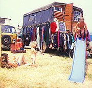 Hippie bohemian kids playing, at Glastonbury, 1989.