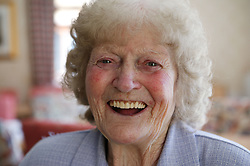 Portrait of an elderly woman laughing,