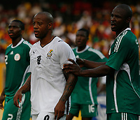 Photo: Steve Bond/Richard Lane Photography.<br /> Ghana v Nigeria. Africa Cup of Nations. 03/02/2008. Junior Agogo (C) is payed close attention to by Daniel Shittu (R)