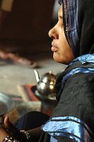 Niger, Agadez, 2007. Takita Ixa, Mohammed Ixa's sister, in the doorway of her room at the family home in Agadez.