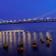 The Bay Bridge is photographed in twilight from San Francisco looking towards Oakland CA. Photography by Dallas commercial photographer William Morton.