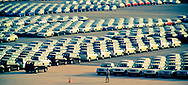 Rows and rows of new cars wait to enter the country at Laem Chabang Port in Thailand .   Most of the international shipments reaching Thailand pass through the port of Laem Chabang.
