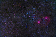 The field of clusters and nebulosity in Auriga, with &mdash; from left to right &mdash; Messier 37, Messier 36, and Messier 38, as the main open star clusters here. Below M38 is NGC 1907. The nebulosity at right is IC 410 and IC 405, the Flaming Star Nebula. In between them is the colourful asterism known as the Little Fish. Messier 38 is also known as the Starfish Cluster while Messier 36 is called the Pinwheel Cluster. The bright red nebula at top is Sharpless 2-235. The litttle nebulas at centre are NGC 1931 and IC 417.<br /><br />The field is similar to that of binoculars. <br /><br />This is a stack of 5 x 3-minute exposures with the Canon 5D MkII at ISO 800 and 200mm Canon L-Series lens at f/2.8.  Taken with the Fornax Lightrack tracker as part of testing. Diffraction spikes added with Astronomy Tools actions. Taken from home on a rare fine and mild winter night, January 4, 2019.