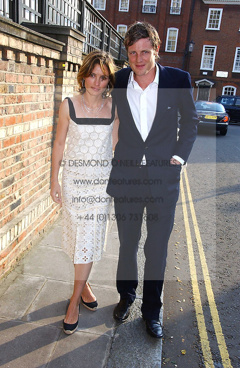 ZAC GOLDSMITH and his wife SHEHERAZADE at Sir David &amp; Lady Carina Frost's annual summer party held in Carlyle Square, Chelsea, London on 5th July 2006.<br />