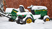 Lawn tractor parked in the snow. Our second snowstorm in two days. Winter has finally arrived. Fuji X-T1 camera and 90mm f/2 lens (ISO 200, 90 mm, f/2, 1/300 sec).