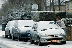 © under license to London News pictures. 27/11/2010. A woman clears snow from her windscreen in the town of Cliford, Bedfordshire this morning (27/11/2010). The whole of the UK is expected experience sub zero temperatures and heavy snowfall over the next few weeks. Photo credit should read: Stephen Simpson/LNP