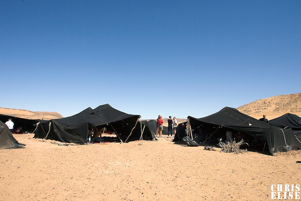 29 March 2007: A view of the bivouac the day off after fourth and longest stage of the 22nd Marathon des Sables between jebel Zireg and west of Kfiroun (43.8 miles). The Marathon des Sables is a 6 days and 151 miles endurance race with food self sufficiency across the Sahara Desert in Morocco. Each participant must carry his, or her, own backpack containing food, sleeping gear and other material.