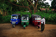 Three tuk tuks and driver, Sri Lanka