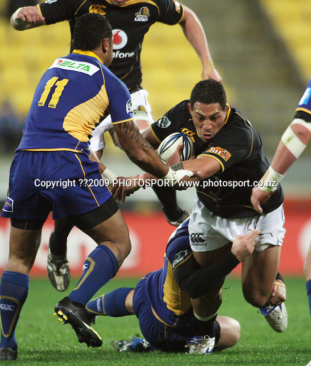 Wellington prop Anthony Perenise is tackled by Brett Mather and Fetu'u Vainkolo (11).<br /> Air NZ Cup Ranfurly Shield match - Wellington Lions v Otago at Westpac Stadium, Wellington, New Zealand. Friday, 31 July 2009. Photo: Dave Lintott/PHOTOSPORT