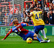 Picture by David Horn/Focus Images Ltd +44 7545 970036<br /> 26/10/2013<br /> Adlene Guedioura of Crystal Palace fouls Serge Gnabry of Arsenal for a penalty during the Barclays Premier League match at Selhurst Park, London.