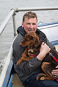 23 March 2019. Boat Race Fixture.  OUWBC vs Molesey BC.<br /> <br /> Pictured:- Umpire Sir Matthew Pinsent CBE aboard the Umpire's launch with his dog.<br /> <br /> As preparation for the The Boat Races, Oxford and Cambridge clubs participate in a number of Fixtures against other clubs, rowing the same Tideway course as used for the Boat Race.<br /> <br /> OUWBC Crew List (Yellow hulled boat):-<br /> Stroke: Amelia Standing, 7. Tina Christmann, 6. Beth Bridgman, 5. Liv Pryer, 4. Lizzie Polgreen, 3. Renée Koolschijn, 2. Anna Murgatroyd, Bow. Issy Dodds, Cox. Eleanor Shearer,