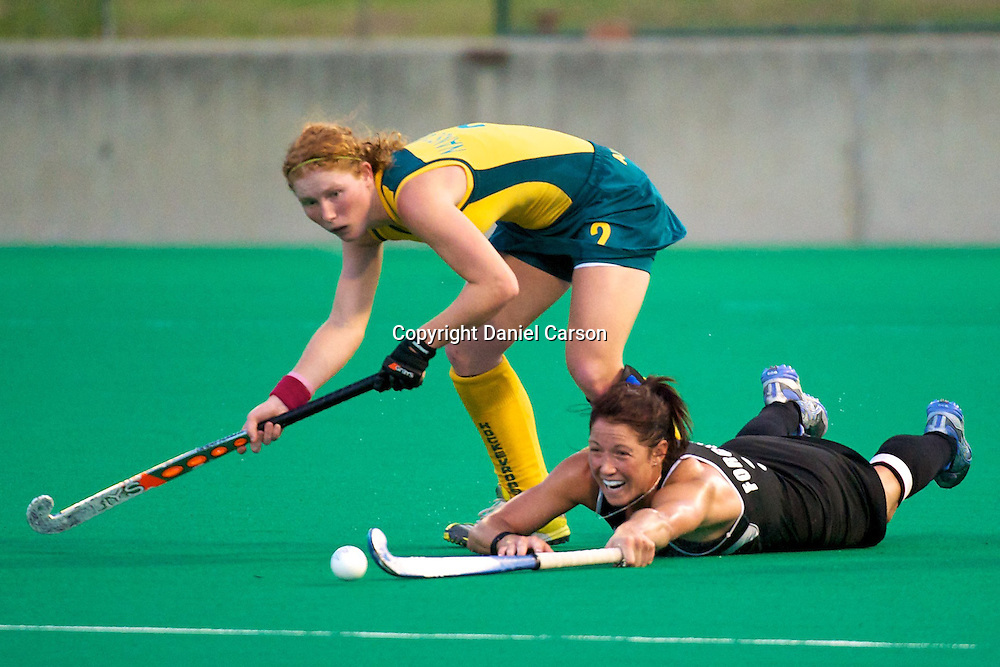 Krystal Forgesson dives under Georgia Nanscawen. Hockeyroos v New Zealand International Hockey match. Curtin Hockey Stadium, Perth. Wednesday 17 February 2010. Photo: Daniel Carson/PHOTOSPORT