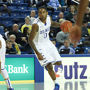 Delaware Guard Davon Usher (0) dribbles the ball up court in the first half of a NCAA regular season Colonial Athletic Association conference game between Delaware and Hofstra Wednesday, JAN 8, 2014 at The Bob Carpenter Sports Convocation Center in Newark Delaware.