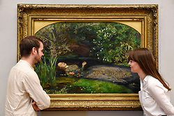 "© Licensed to London News Pictures. 05/09/2018. LONDON, UK.  Staff members view ""Ophelia"", 1851-52, by John Everett Millais, at Tate Britain, to mark the launch of a major new exhibition at the National Gallery of Australia (NGA) in December 2018.  Over forty Pre-Raphaelite works will be loaned by Tate to NGA, which have never been shown in Australia until now, including ""Ophelia"", 1851-52, by John Everett Millais and ""The Lady of Shalott"", 1888, by John William Waterhouse.  Photo credit: Stephen Chung/LNP"