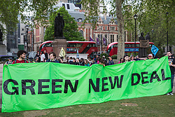 London, UK. 1st May, 2019. A Green New Deal banner among climate protesters attending a Declare A Climate Emergency Now demonstration in Parliament Square organised to coincide with a motion in the House of Commons to declare an environment and climate emergency tabled by Leader of the Opposition Jeremy Corbyn. The motion, which does not legally compel the Government to act, was passed without a vote.