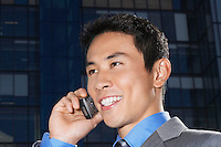 Smiling Businessman Using Cell Phone close-up