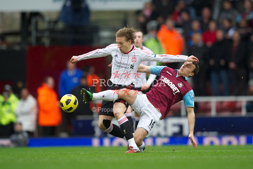 LONDON, ENGLAND - Sunday, February 27, 2011: Liverpool's Lucas Leiva and West Ham United's Mark Noble during the Premiership match at Upton Park. (Photo by David Rawcliffe/Propaganda)