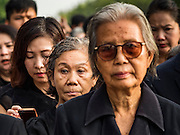 14 OCTOBER 2016 - BANGKOK, THAILAND: People stand in line to enter the Grand Palace in Bangkok to pay respects to Bhumibol Adulyadej, the King of Thailand, who died Oct. 13, 2016. He was 88. His death comes after a period of failing health. With the king's death, the world's longest-reigning monarch is Queen Elizabeth II, who ascended to the British throne in 1952. Bhumibol Adulyadej, was born in Cambridge, MA, on 5 December 1927. He was the ninth monarch of Thailand from the Chakri Dynasty and is known as Rama IX. He became King on June 9, 1946 and served as King of Thailand for 70 years, 126 days. He was, at the time of his death, the world's longest-serving head of state and the longest-reigning monarch in Thai history.     PHOTO BY JACK KURTZ