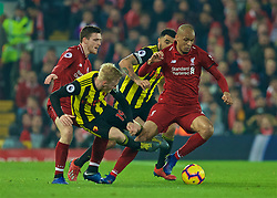LIVERPOOL, ENGLAND - Wednesday, February 27, 2019: Liverpool's Fabio Henrique Tavares 'Fabinho' is tackled by Watford's Will Hughes during the FA Premier League match between Liverpool FC and Watford FC at Anfield. (Pic by Paul Greenwood/Propaganda)