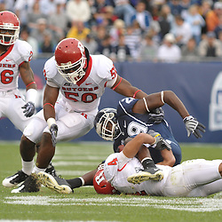 Oct 31, 2009; East Hartford, CT, USA; Connecticut wide receiver Eric Sawicki (29) is tackled by Rutgers cornerback David Rowe (4) and linebacker Antonio Lowery (50) during second half Big East NCAA football action in Rutgers' 28-24 victory over Connecticut at Rentschler Field.