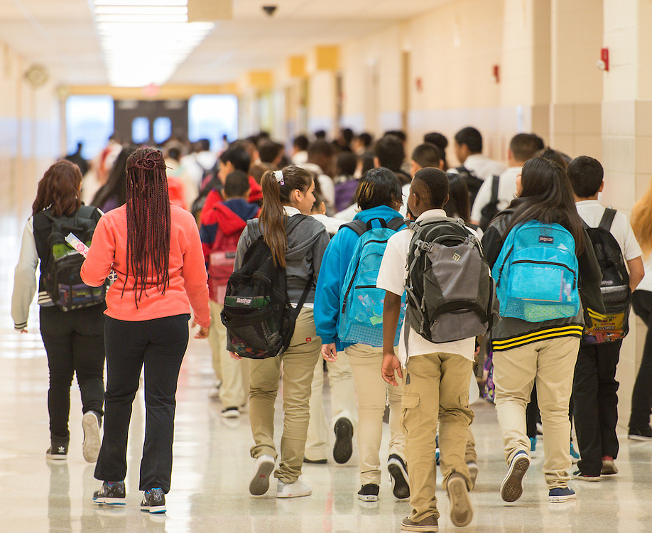 Students walk down hallway at Ortiz Middle School, September 3, 2015.