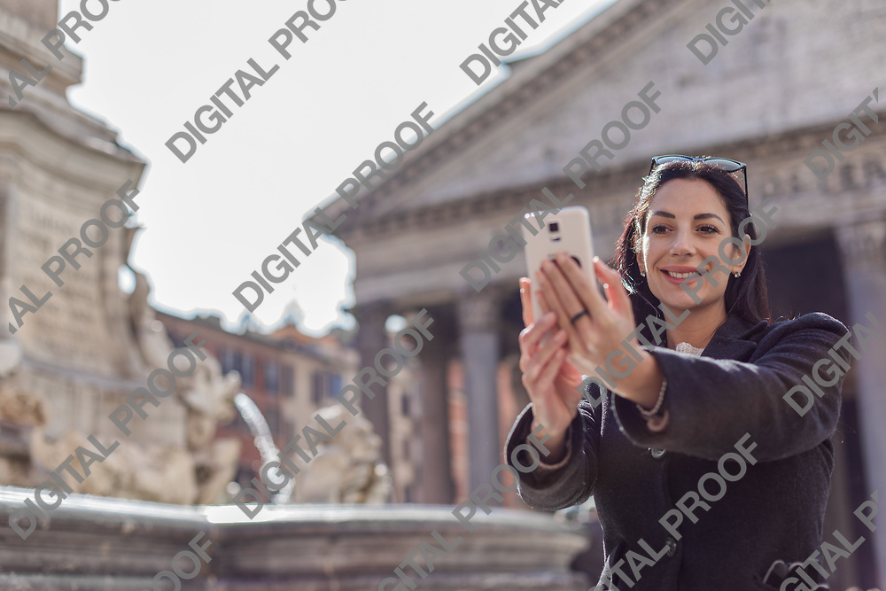 Happy executive  woman making selfie in front of Pantheon in rome, italy