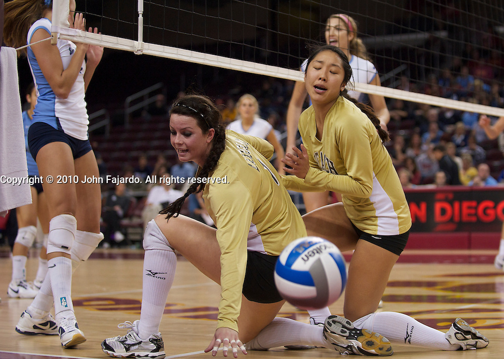 The ball gets past Caitlin Ledoux(L) and Ashley Lee(R) in the first round match against the University of San Diego in the 2010 NCAA Women's Volleyball Tournament at the Galen Center, Los Angeles, Calif., Friday, Dec. 3, 2010