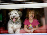 Hannah White, 5, has been spending time all week looking out the window of her home in Coral Gables with her dog Buddy. Today is another rainy day in South Florida on Tuesday June 2, 2009.