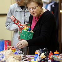Adam Robison | BUY AT PHOTOS.DJOURNAL.COM<br /> St. Luke United Methodist Church member Karen Conwill packs a shoe box for a little girl that will be shipped overseas for Operation Christmas Child Wednesday night at St Luke United Methodist Church in Tueplo.