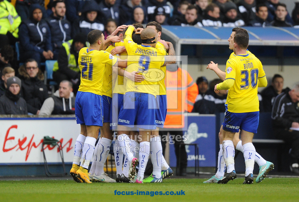 Sean Scannell (7) of Huddersfield Town celebrates after scoring the opening goal with his team mates during the Sky Bet Championship match at The Den, London<br /> Picture by Alan Stanford/Focus Images Ltd +44 7915 056117<br /> 07/02/2015