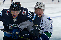 PENTICTON, CANADA - SEPTEMBER 8: Brock Boeser #6 of Vancouver Canucks checks Cristiano DaGiacinto #87 of Winnipeg Jets into the boards during third period on September 8, 2017 at the South Okanagan Event Centre in Penticton, British Columbia, Canada.  (Photo by Marissa Baecker/Shoot the Breeze)  *** Local Caption ***