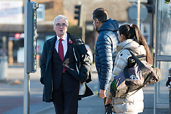 © Licensed to London News Pictures. 29/10/2018. London, UK.  JOHN MCDONNELL, Labour Shadow Chancellor waits at a bus stop to catch a bus from his London home as he heads for Parliament on Budget day.  Photo credit: Vickie Flores/LNP
