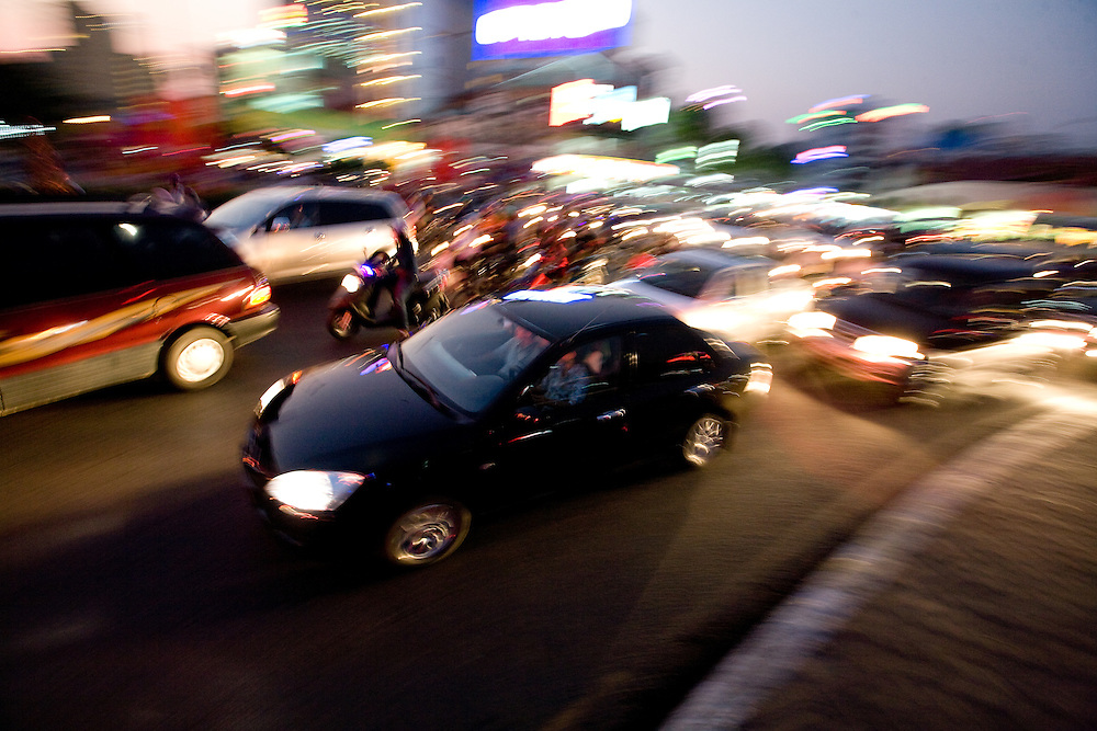 nightly traffic close to Saigon's famous Ben Thanh Market. Cars and motorbikes.